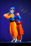 Little children dancing with old oriental costumes on stage Royalty Free Stock Photos