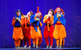 Little children dancing with old oriental costumes on stage Stock Photography