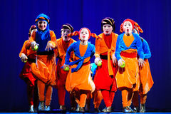 Little children dancing with old oriental costumes on stage Royalty Free Stock Images