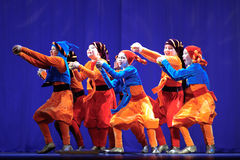 Little children dancing with old oriental costumes on stage Royalty Free Stock Image