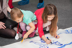 little children draw picture in Kindergarten Stock Image