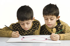 Little children drawing heart Stock Photo