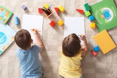 Little children drawing indoors. Learning and playing stock photo