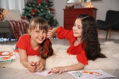 Little children with drawings and letter to Santa. At home. Christmas celebration stock photo