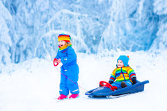 Little children enjoying a sleigh ride Royalty Free Stock Photo