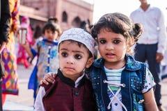 Little children facing camera at Jama Masjid, Delhi Stock Photo