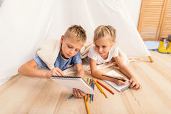 Little children fond of painting at home stock photos
