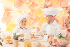 little children in the form of a chef to prepare delicious Royalty Free Stock Photography