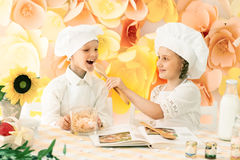 little children in the form of a chef to prepare delicious Stock Photography