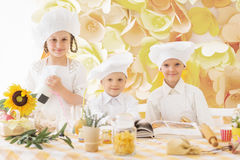 little children in the form of a chef to prepare delicious Royalty Free Stock Photos