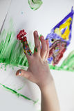 Little Children Hands doing Fingerpainting Royalty Free Stock Photography