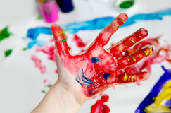 Little Children Hands doing Fingerpainting royalty free stock image