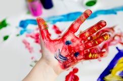 Little Children Hands doing Fingerpainting royalty free stock image