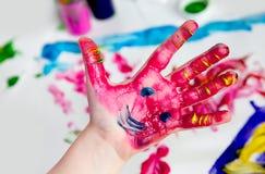 Little Children Hands doing Fingerpainting stock photography
