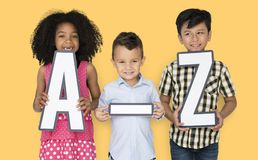 Little Children Holding A-Z Papercraft royalty free stock image
