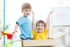 Little children inside a paper box Royalty Free Stock Images
