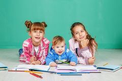 Little children learn to write and read. The concept of childhood, learning, friendship, family, school lifestyle stock photography