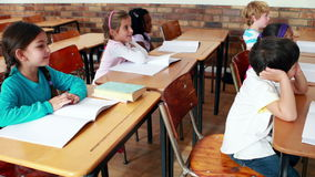 Little children listening in classroom. In elementary school stock video footage