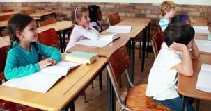 Little children listening in classroom. In elementary school stock footage
