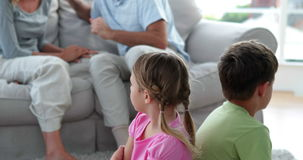 Little children listening to their parents fighting on the couch
