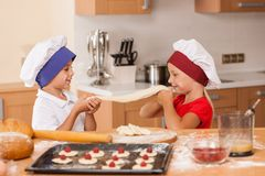 Little children making bakery and playing. Stock Photo