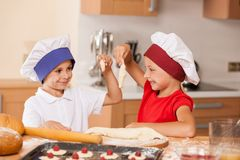 Little children making bakery and smiling. Stock Photography