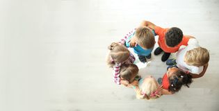 Little children making circle with hands around stock photos