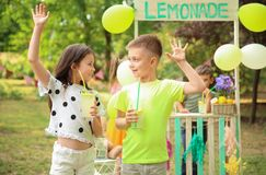Little children with natural lemonade Stock Photos