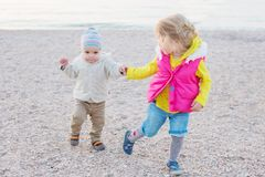 Little children, older sister teaches brother to walk Stock Photography
