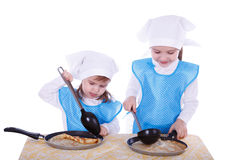 Little children with pancakes Stock Photos