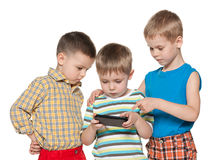 Little children plaing with smartphone Royalty Free Stock Photo