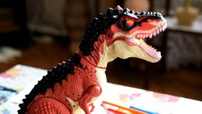 Little children play with a toy dinosaur. Produced in 4K stock video footage
