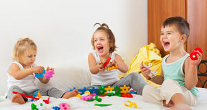 Little children playing on bed royalty free stock photo
