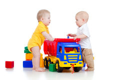 Little children playing with color toys Stock Image