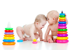 Little children playing with color toys Stock Images