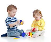 Little children playing with colorful toy Stock Photo