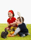 Little children playing with Easter bunny Stock Photography