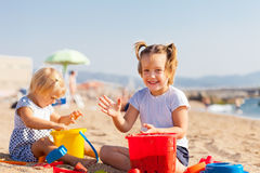 Little children playing with sand Stock Photo
