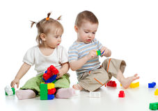 Little children playing together with colorful toy Stock Photos