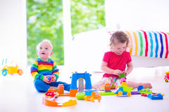 Little children playing with toy cars Stock Images