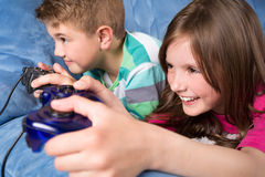 Little children playing video games Royalty Free Stock Image