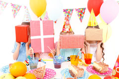 Little children posing with birthday presents royalty free stock image