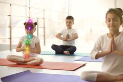 Little children practicing yoga