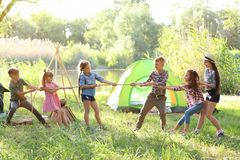 Little children pulling rope outdoors Stock Photos