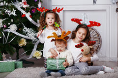 Little children in reindeer antlers royalty free stock photography