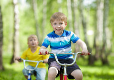 Little children riding their bikes Royalty Free Stock Photo