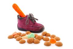 Little children's shoe with carrot Royalty Free Stock Image