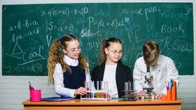 Little children at school lesson. Chemistry. Back to school. students doing experiments with microscope. childrens day royalty free stock image