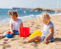 Little children  at sea Stock Photos