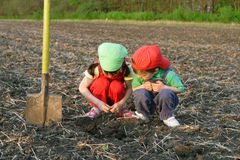 Little children with shovel on field Royalty Free Stock Image